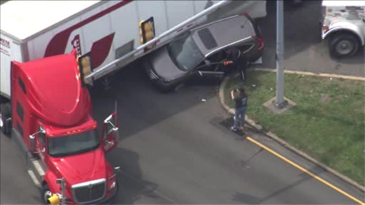 SUV pinned under truck on Roosevelt Blvd.
