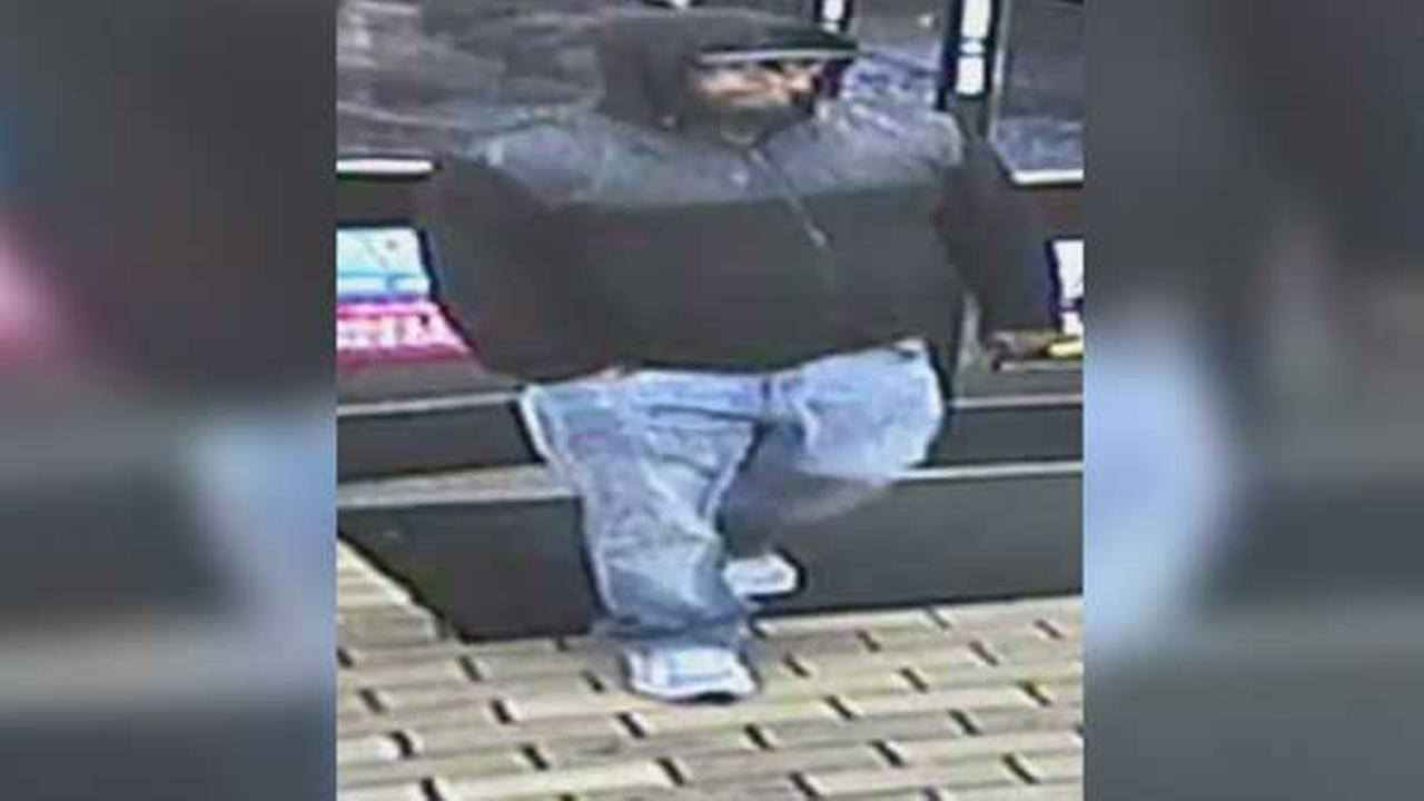 Philadelphia police are searching for a suspect who robbed a 7-Eleven store at gunpoint in the citys Mayfair section.