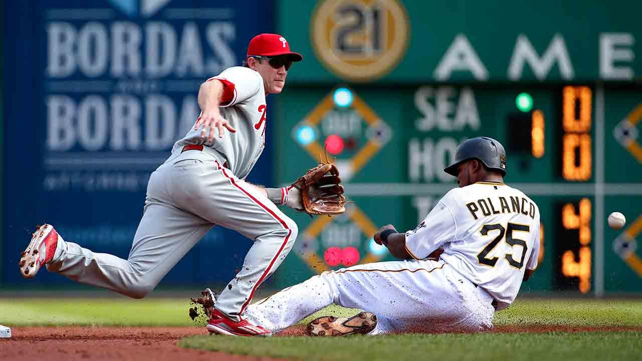 Pittsburgh Pirates Gregory Polanco (25) steals second as Philadelphia Phillies second baseman Chase Utley waits for the late throw from catcher Carlos Ruiz.