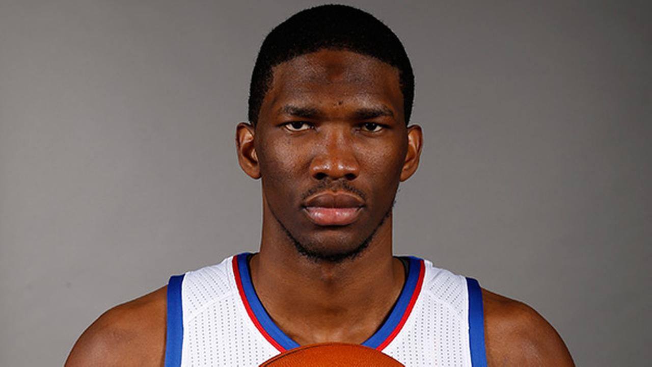 Philadelphia 76ers Joel Embiid, of Cameroon, poses for a photo during the NBA basketball teams media day, Monday, Sept. 29, 2014, in Philadelphia.