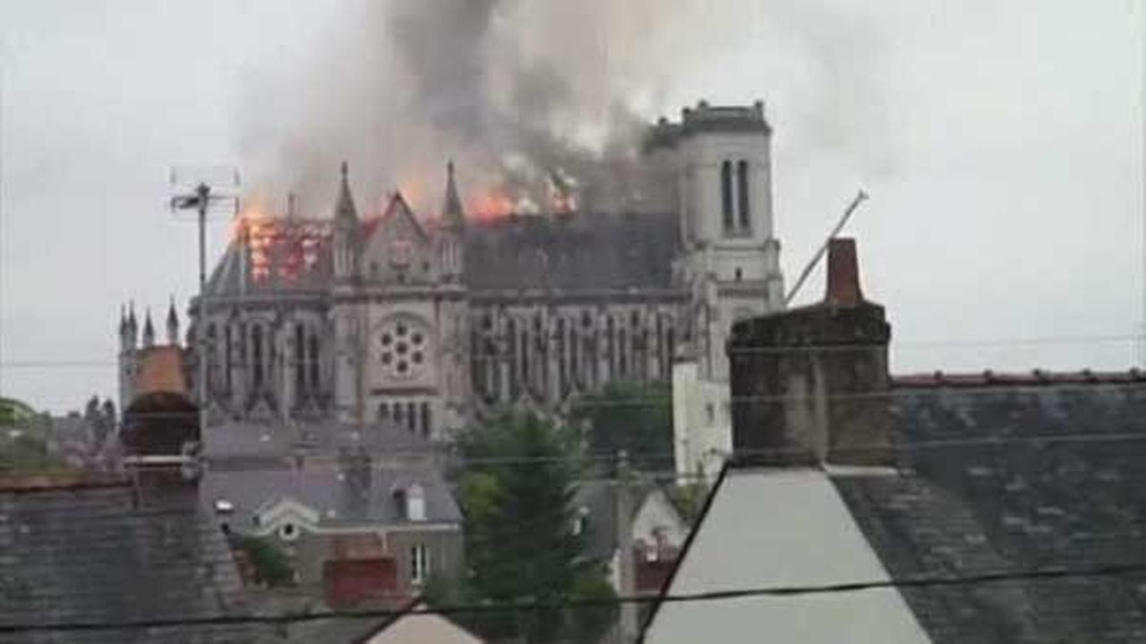 Fire erupted inside a 19th century church in Western France Monday just after morning mass.