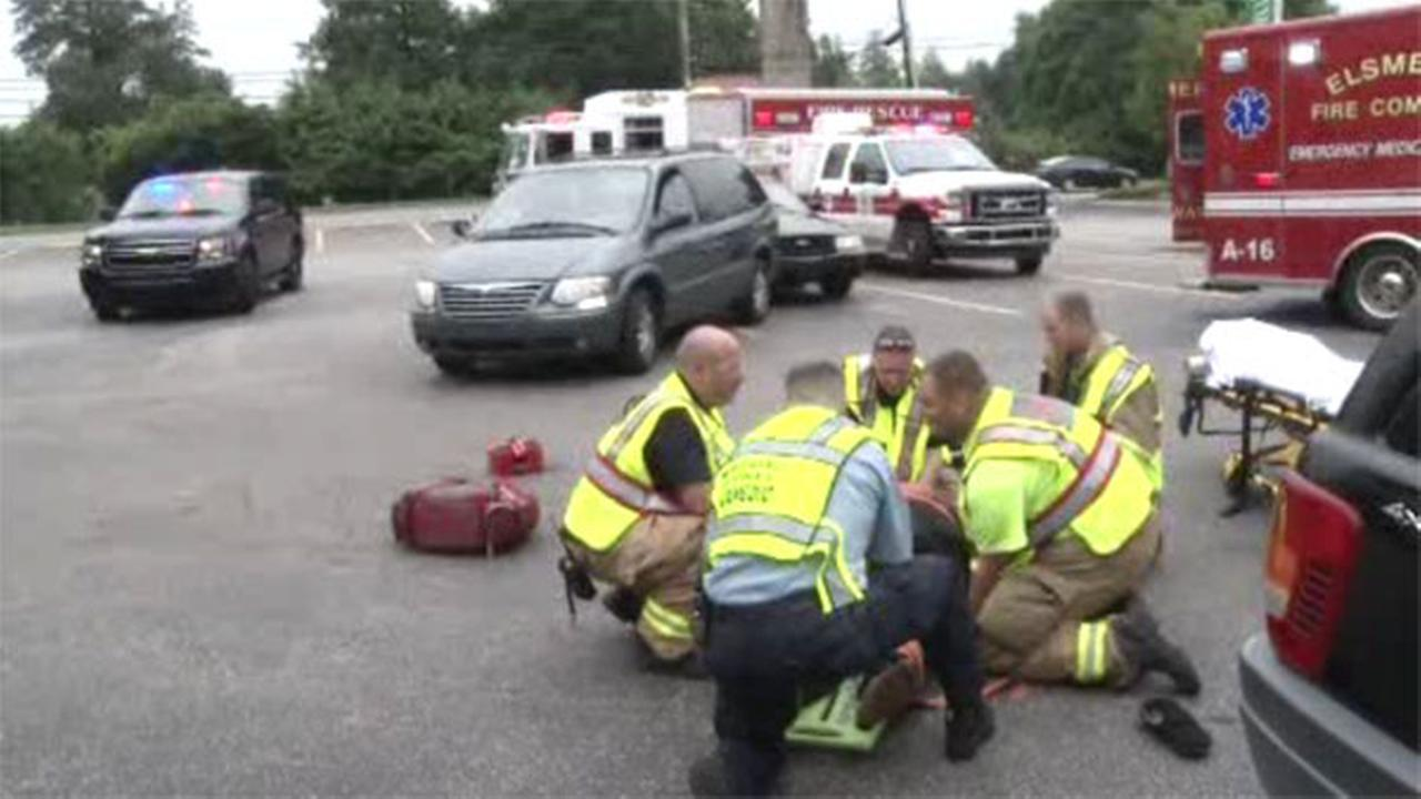 Woman accidentally hit while getting out of car