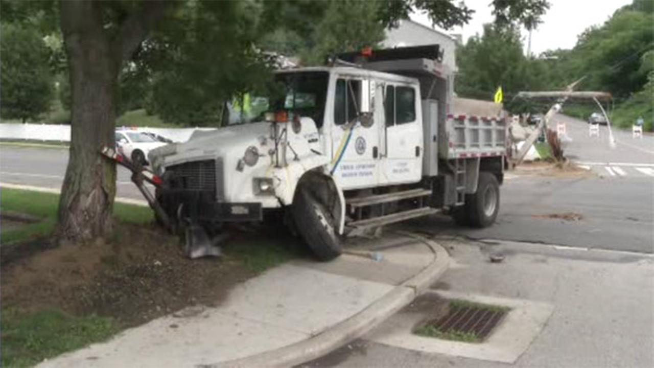 Dump truck crashes into utility pole in Roxborough
