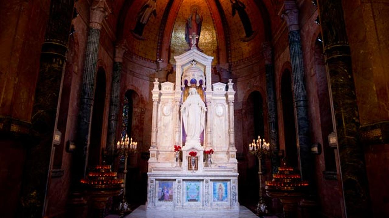 A statue of Our Lady of the Miraculous Medal stands at an altar, Thursday, June 18, 2015, in Philadelphia.