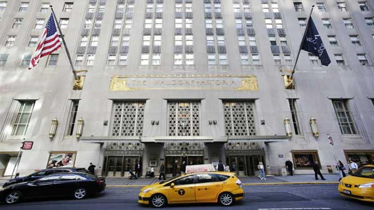 A taxi passes in front of the fabled Waldorf Astoria hotel, Monday, Oct. 6, 2014 in New York.