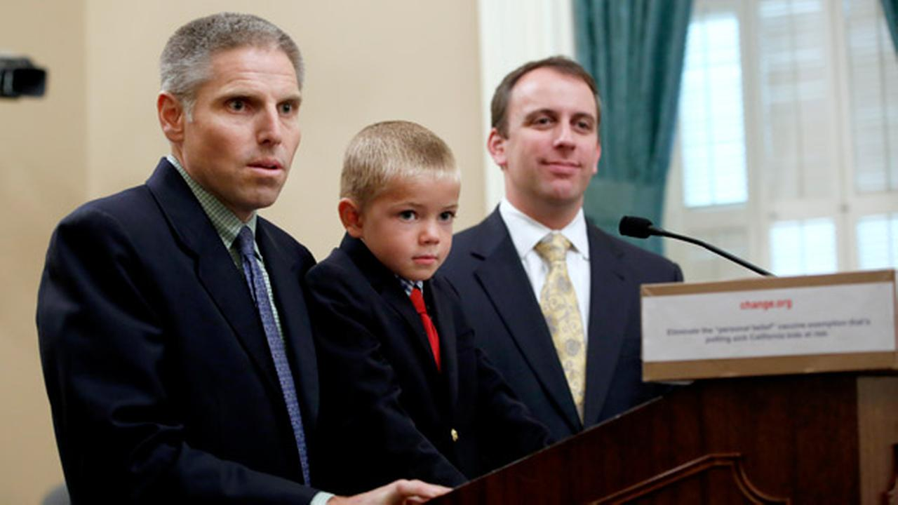Carl Krawitt, left, a supporter of a measure requiring nearly all of California school children to be vaccinated, answers a question during a news conference in Sacramento, Calif.