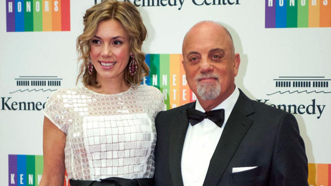 In this Dec. 7, 2013 file photo, Kennedy Center Honoree Billy Joel,right, and Alexis Roderick arrive at the Kennedy Center Honors gala dinner in Washington.