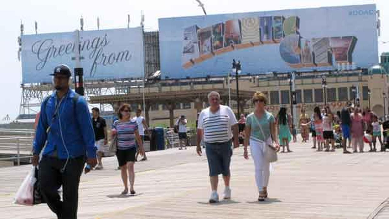 Crowds walk on the Atlantic City N.J. Boardwalk on Friday, July 3, 2015.