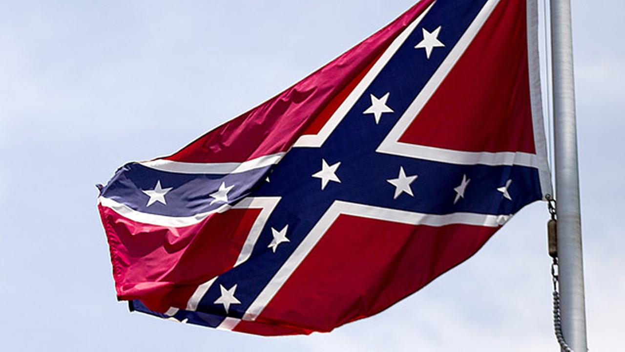 FILE - In this June 30, 2015 file photo, a Confederate flag flies at the base of Stone Mountain in Stone Mountain, Ga.