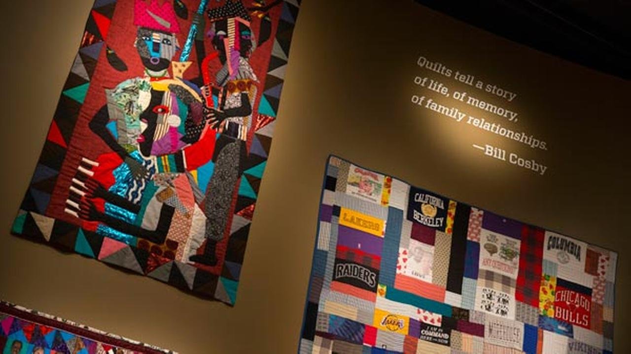 FILE - In this Nov. 6, 2014, file photo, quilts from the Bill and Camille Cosby collection hang at the Smithsonians National Museum of African Art in Washington.