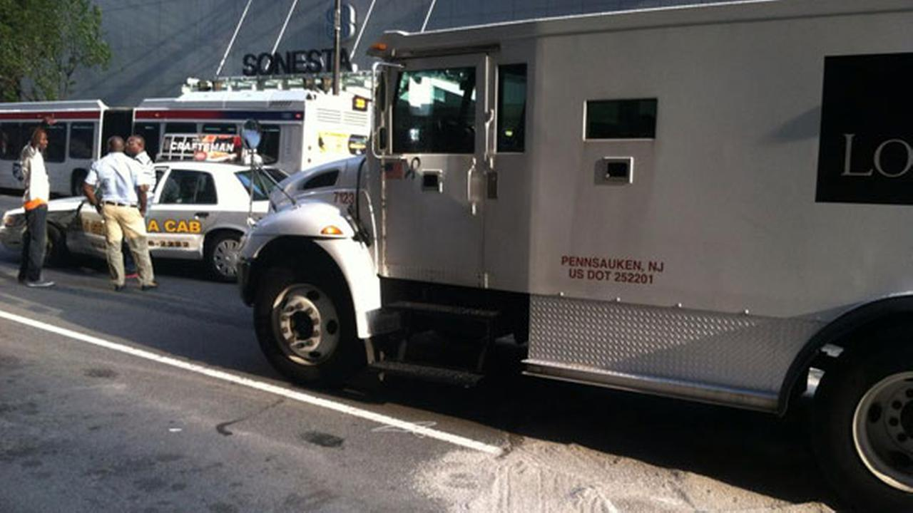 Taxi collides with armored car in Center City