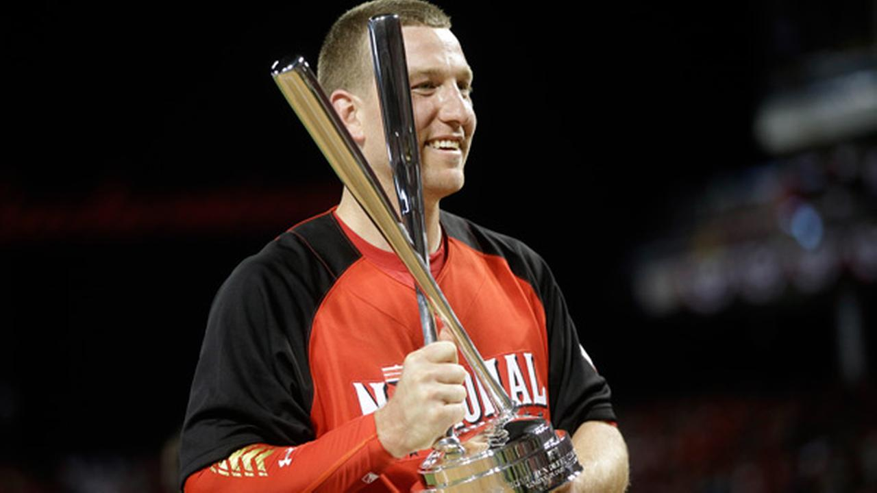 National Leagues Todd Frazier, of the Cincinnati Reds, holds the trophy after winning the MLB All-Star baseball Home Run Derby, Monday, July 13, 2015, in Cincinnati.