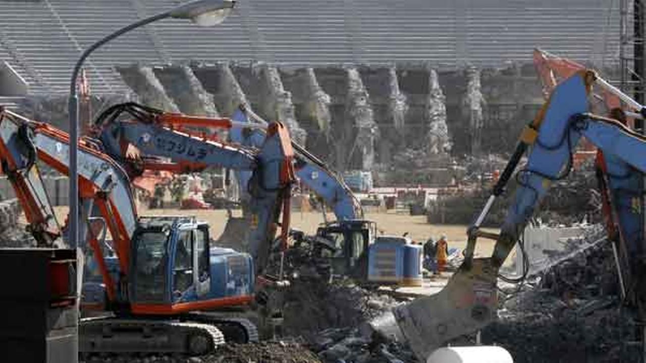 FILE - In this March 5, 2015 file photo, Japans National Stadium is dismantled for the renovation for the 2020 Tokyo Olympic Games, in Tokyo.