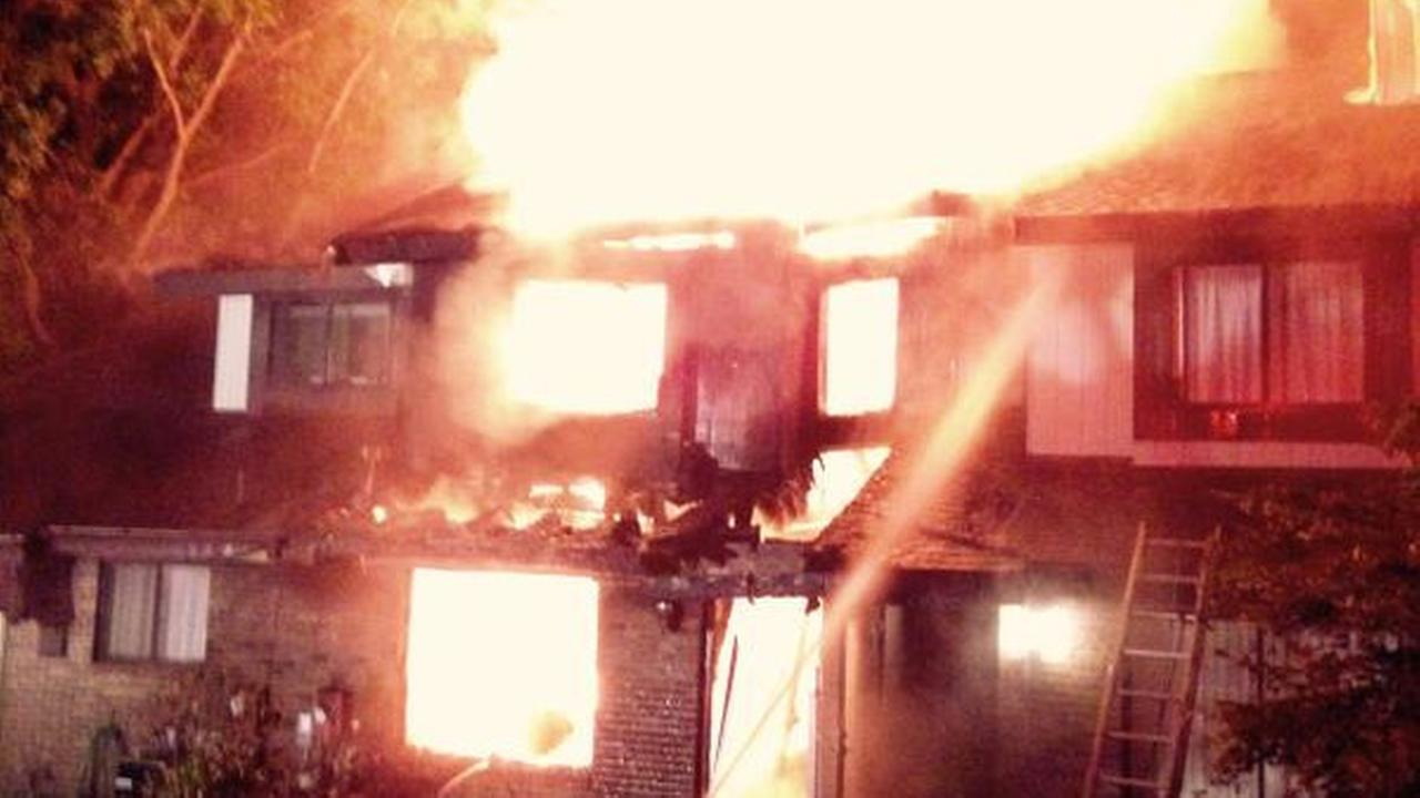 Flames rip through townhome in New Castle