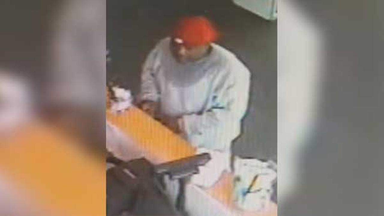 Philadelphia police are looking for a man who robbed a shoe store in the citys Hunting Park section.