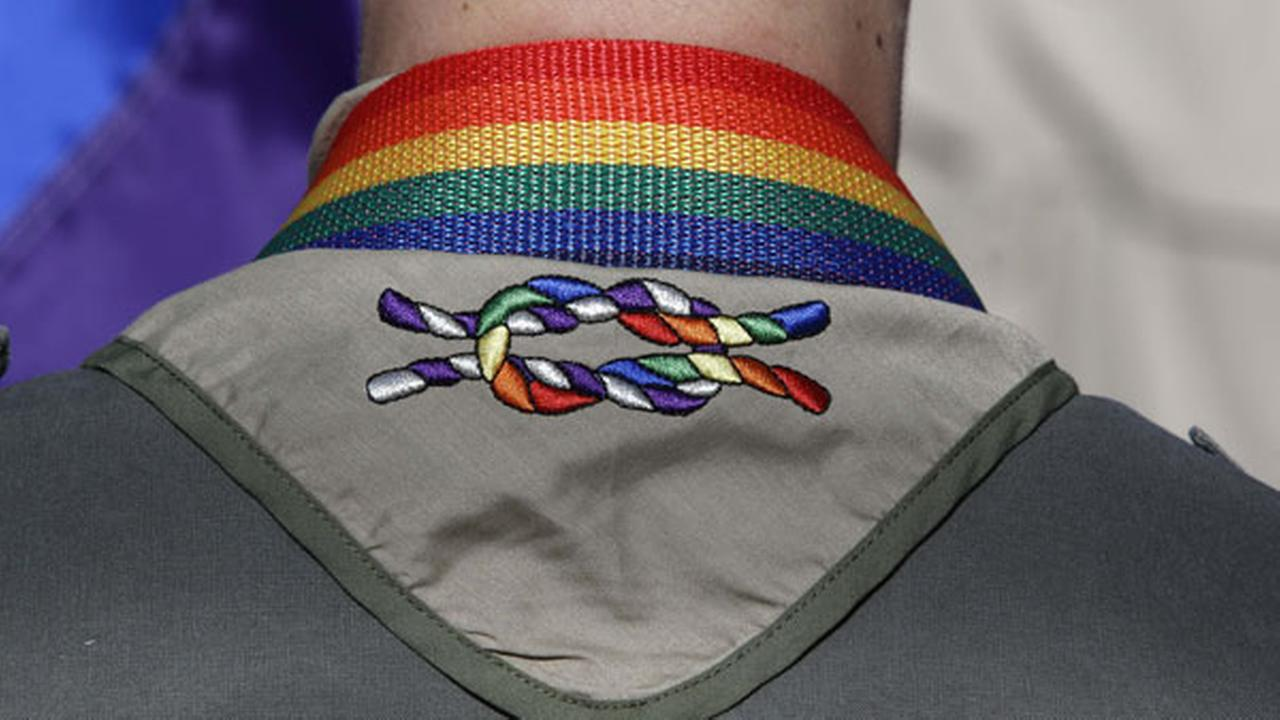 FILE - In this Sunday, June 8, 2014, file photo, a Boy Scout wears his kerchief embroidered with a rainbow knot during Salt Lake Citys annual gay pride parade.