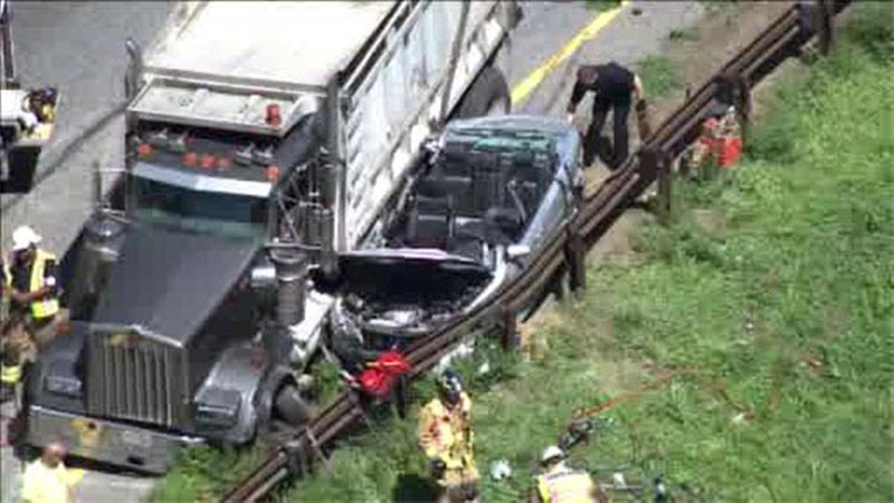 Car wedged between dump truck and guardrail on I-476