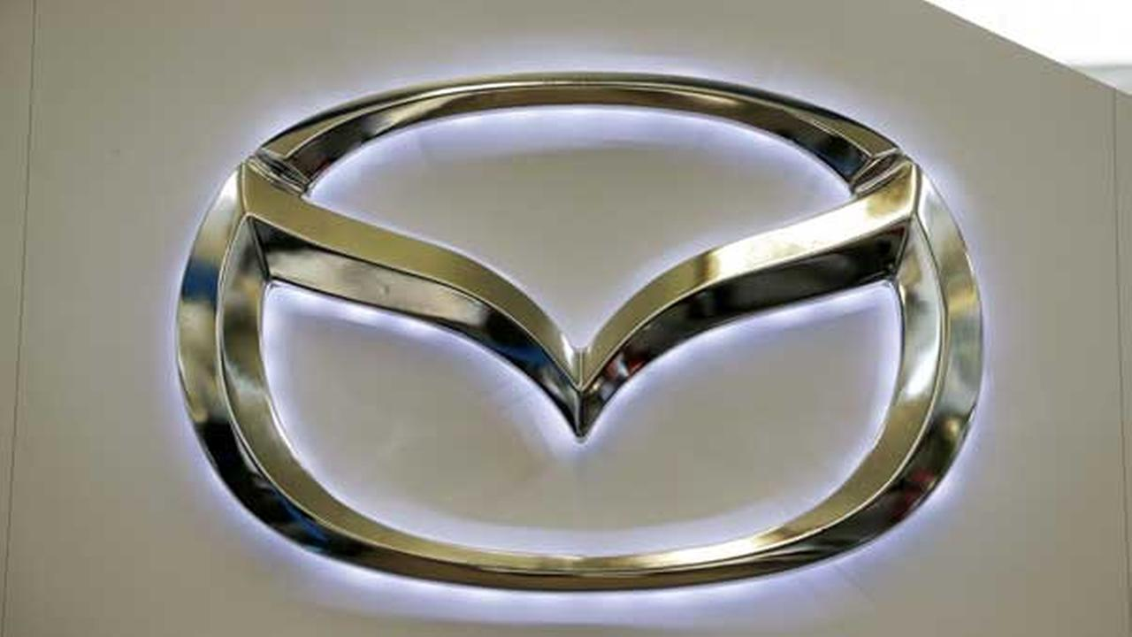 FILE - This Feb. 14, 2013 file photo shows the Mazda logo on a sign at the 2013 Pittsburgh Auto Show, in Pittsburgh.
