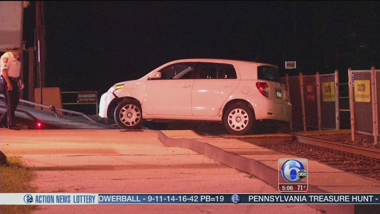 VIDEO: Driver gets stuck on train tracks in Delco