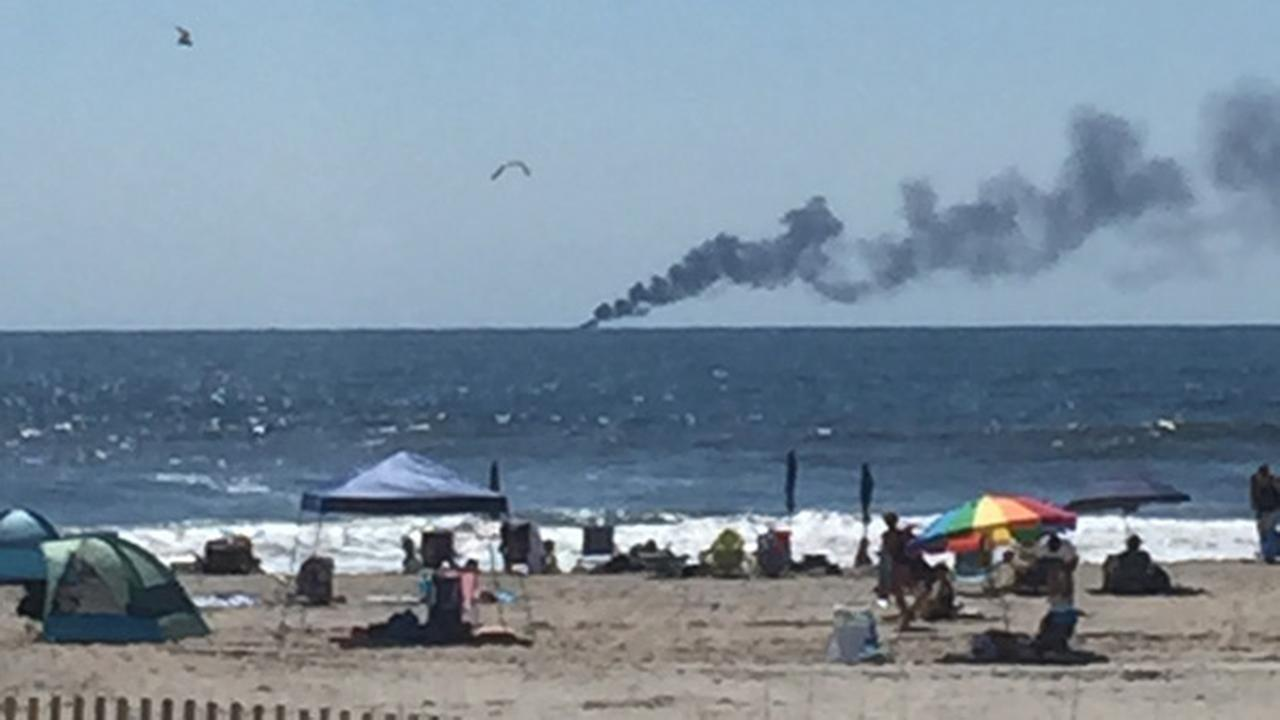 2 people, dog rescued from burning boat off Ocean City coast