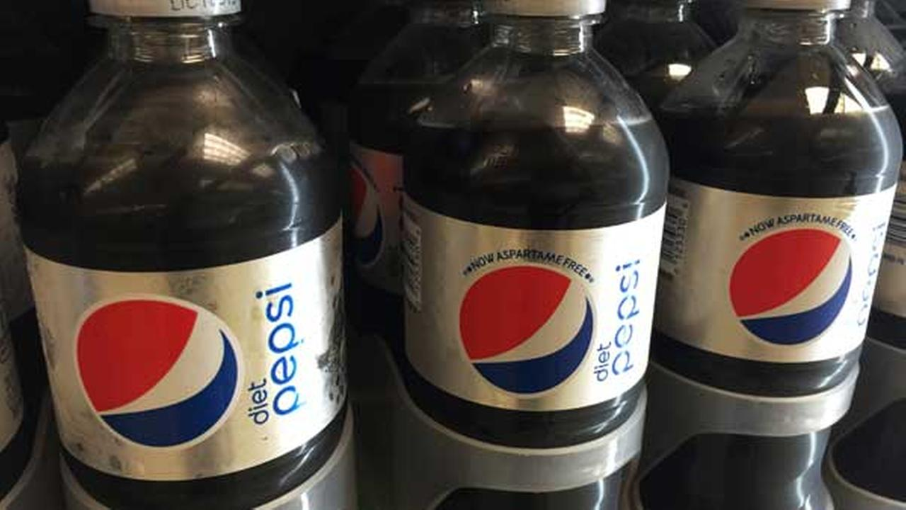 In this Saturday, Aug. 8, 2015 photo, bottles of Diet Pepsi with, left, and without aspartame, center and right, sit in a case at a store in New York.