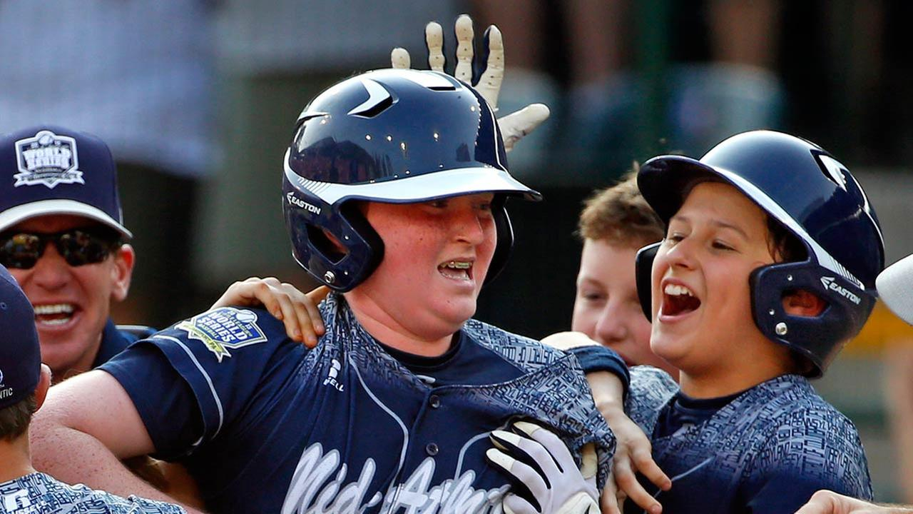 Lewisberry, Pa.s Chayton Krauss (25) celebrates with teammate Adam Cramer (10) after the Little League World Series tournament in South Williamsport, Pa., Saturday, Aug. 29, 2015