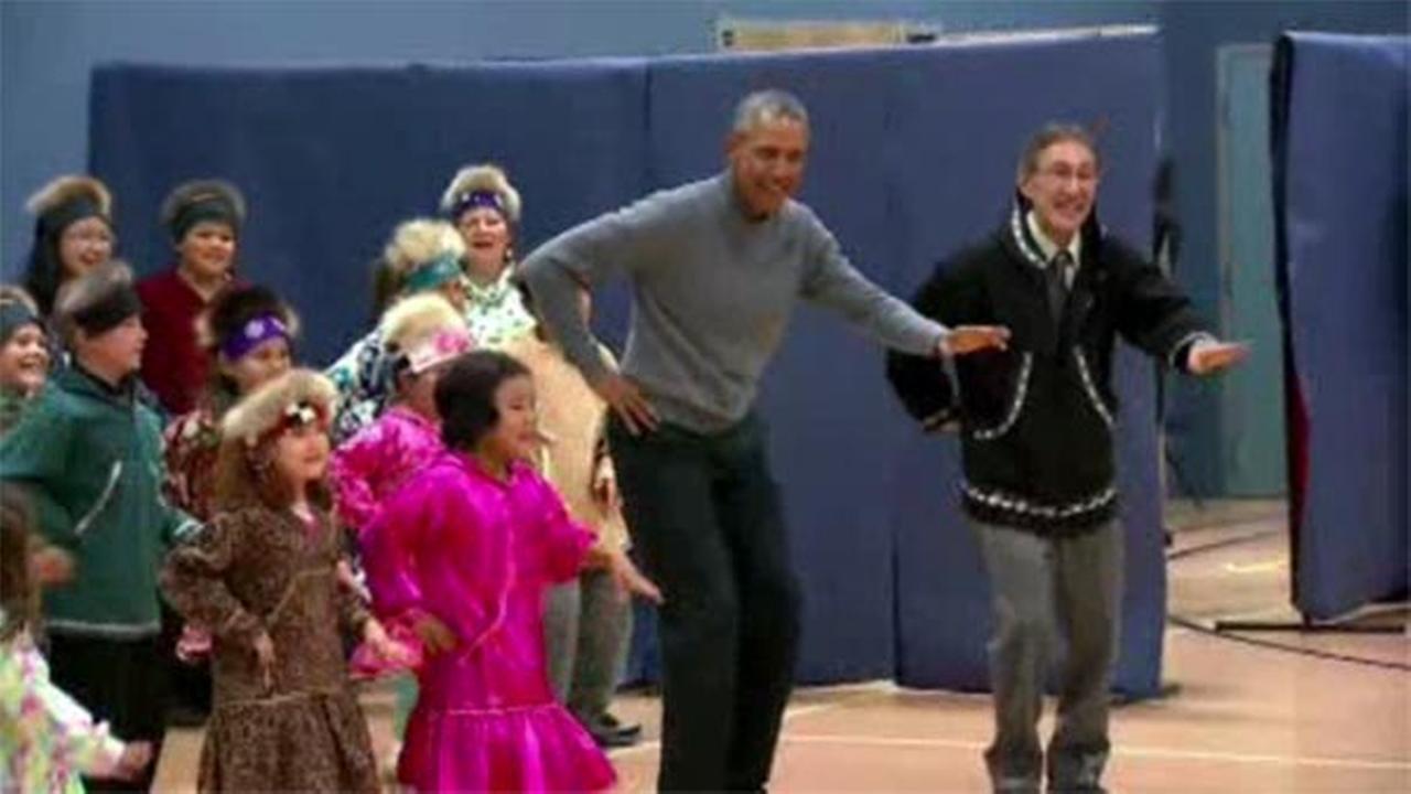 President Obama takes part in native dance