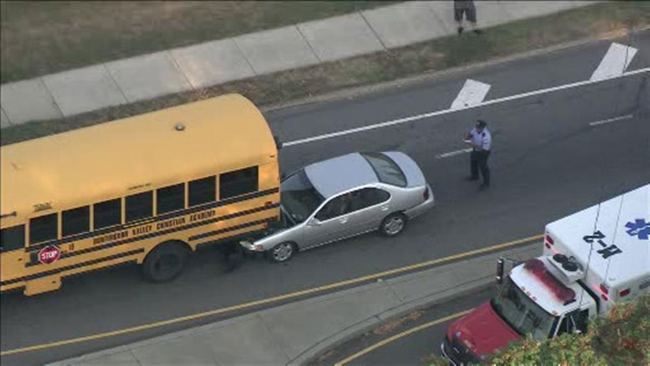 Car wedged under school bus in Juniata