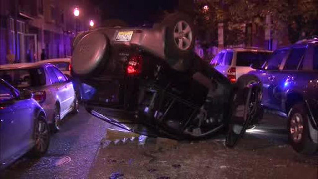 SUV overturns on South Street, 1 injured