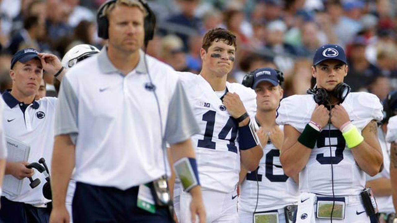 Penn State quarterbacks Christian Hackenberg (14), Billy Fessler (16) and Trace McSorley (9) watch from the sidelines during the second half of a game against Temple.