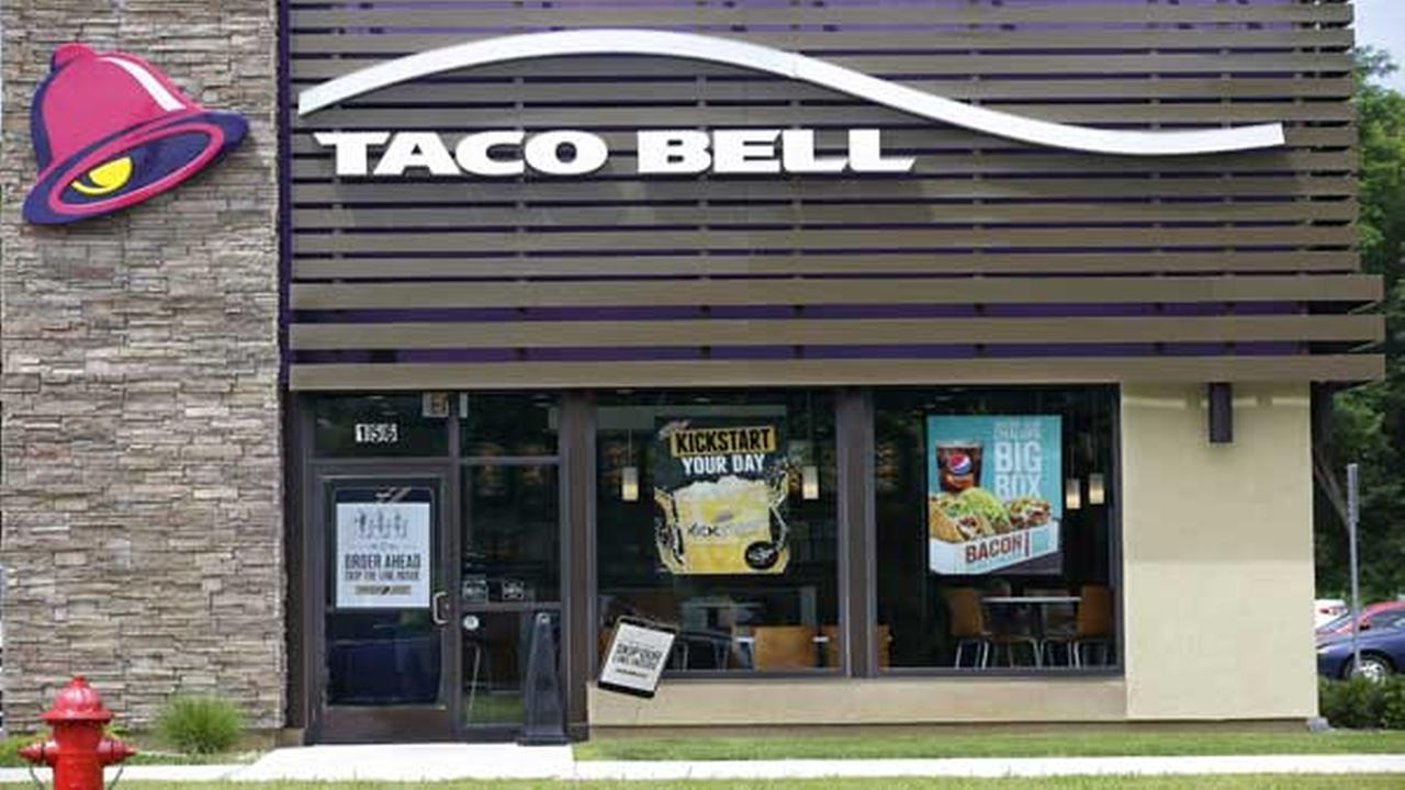 This Thursday, July 9, 2015 photo shows a Taco Bell, a Yum Brands restaurant, in Pembroke, Mass.