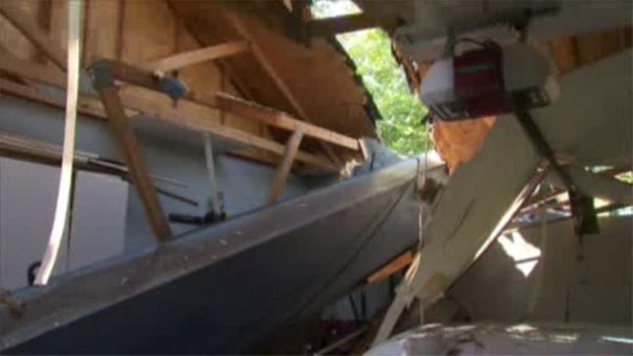 Crane smashes through Ohio home