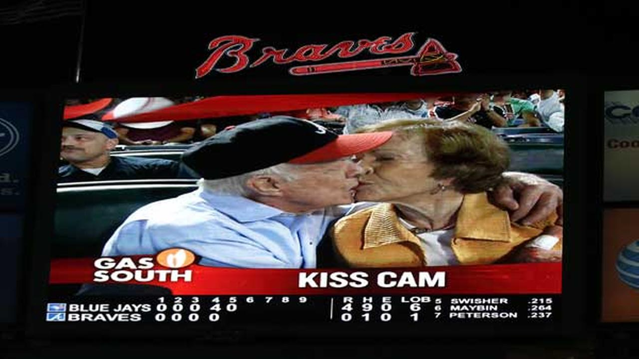Former President Jimmy Carter kisses his wife,Rosalynn, on the Kiss Cam during a baseball game between the Atlanta Braves and the Toronto Blue Jays Sept. 17, 2015, in Atlanta.