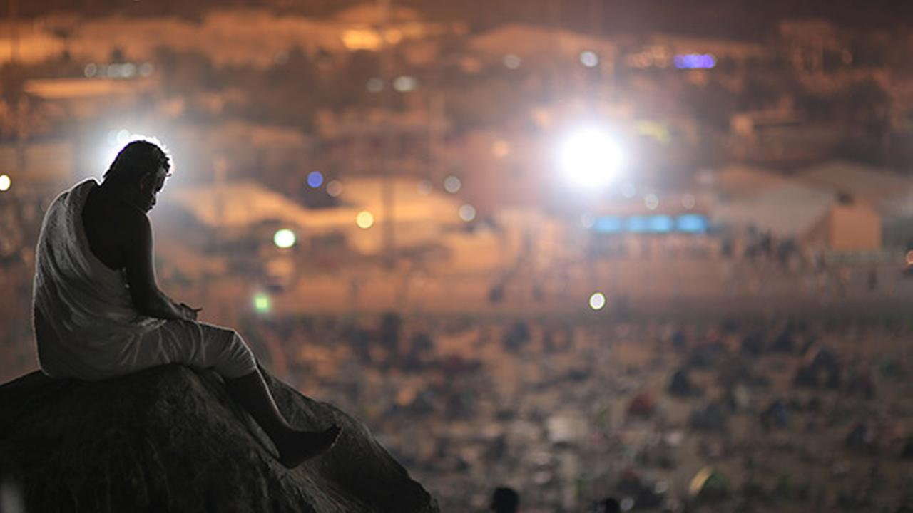 A Muslim pilgrim prays on a rocky hill called the Mountain of Mercy, on the Plain of Arafat, near the holy city of Mecca, Saudi Arabia, Wednesday, Sept. 23, 2015 during the hajj.