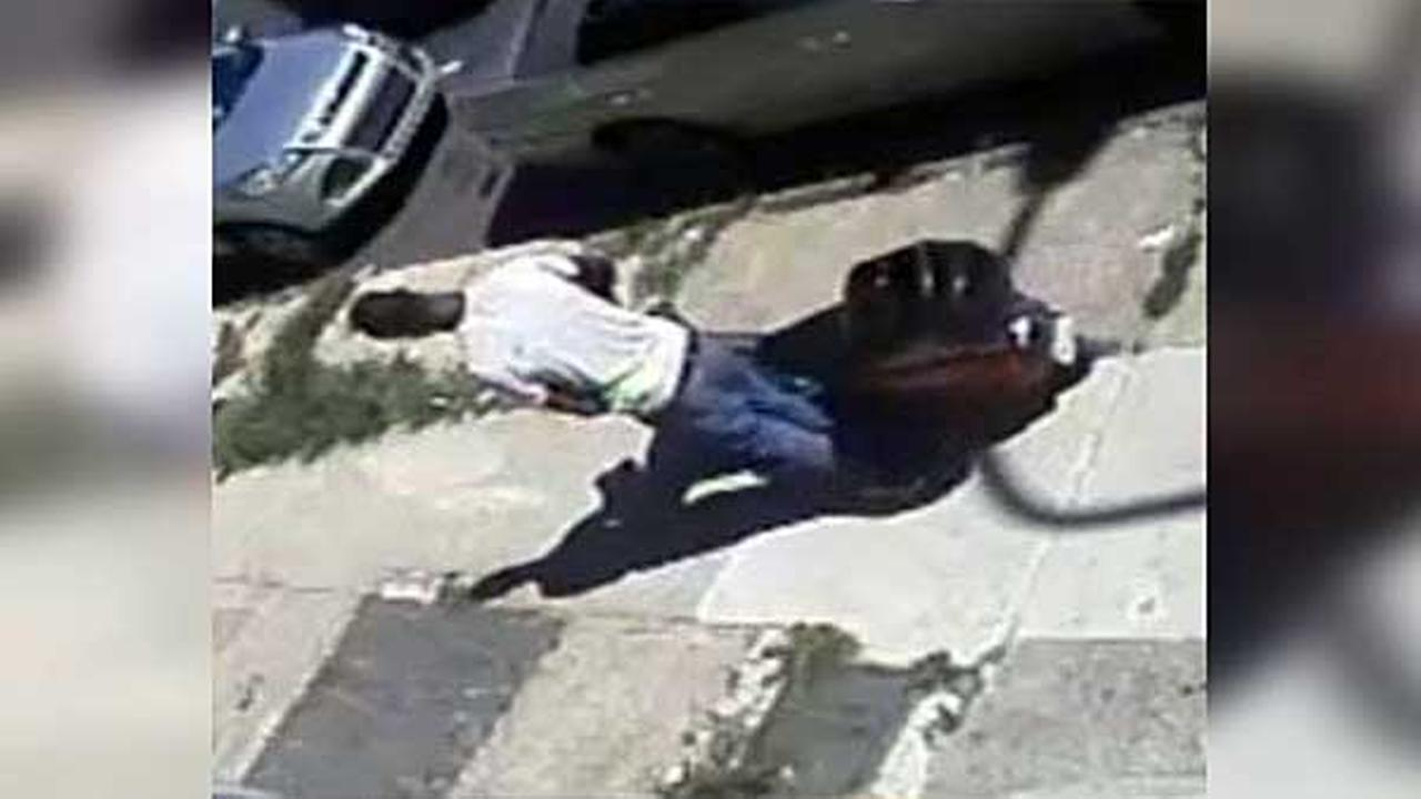 Police are searching for two men who swiped a locked scooter from the front of a home in North Philadelphia.