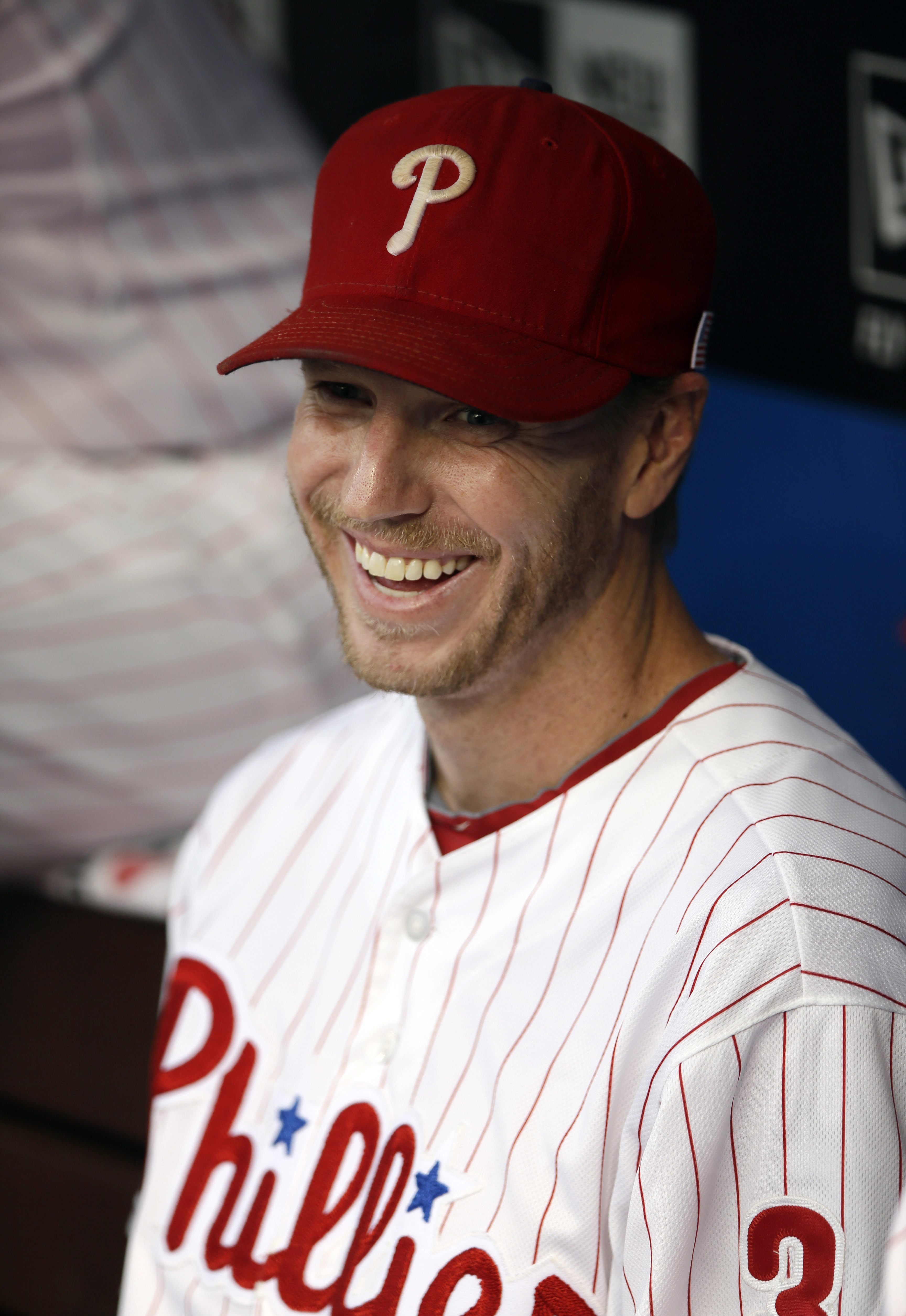 Roy Halladay enjoys a moment in the Phillies dugout in September 2013.
