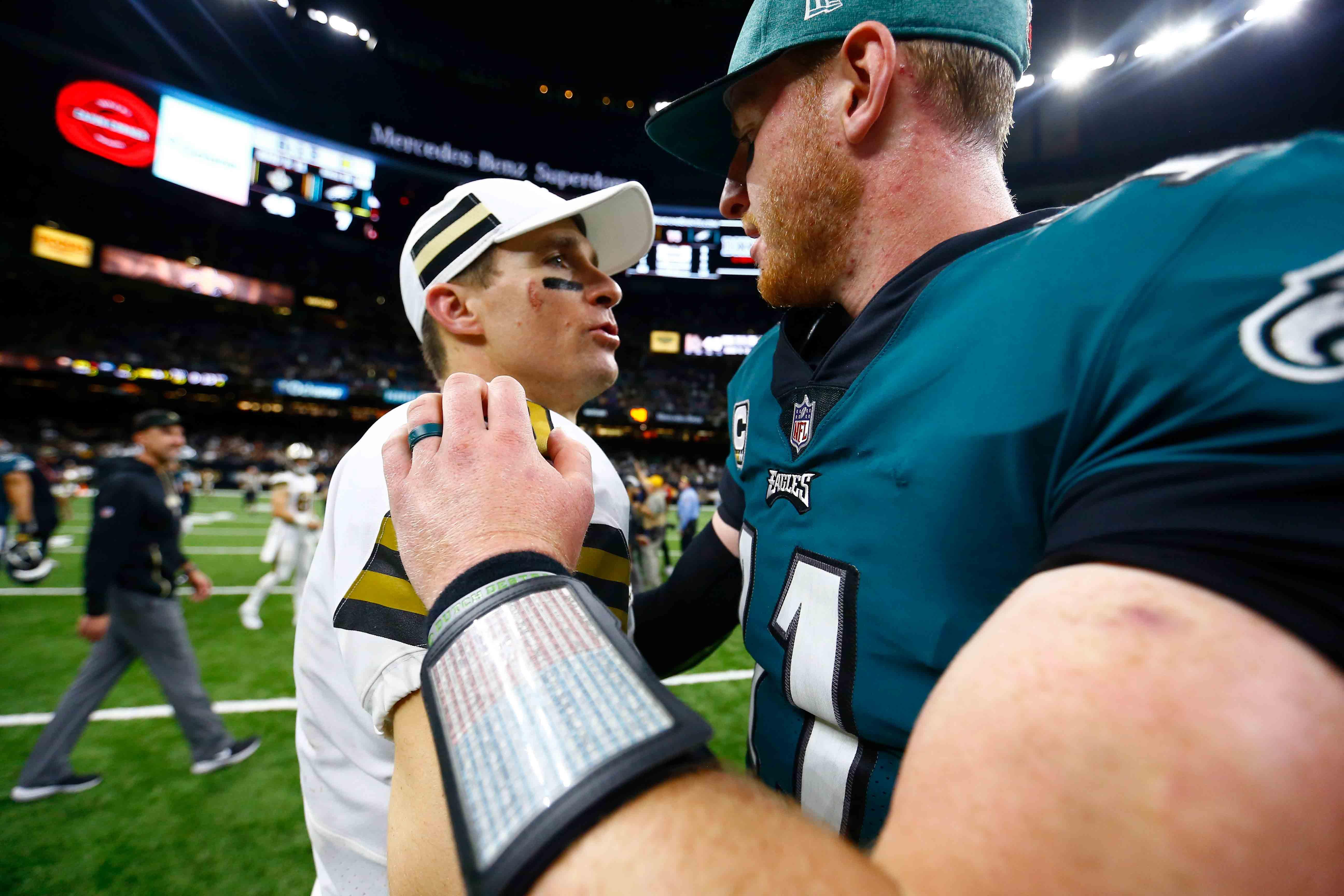 New Orleans Saints quarterback Drew Brees greets Philadelphia Eagles quarterback Carson Wentz (11) after an NFL football game in New Orleans, Sunday, Nov. 18, 2018.