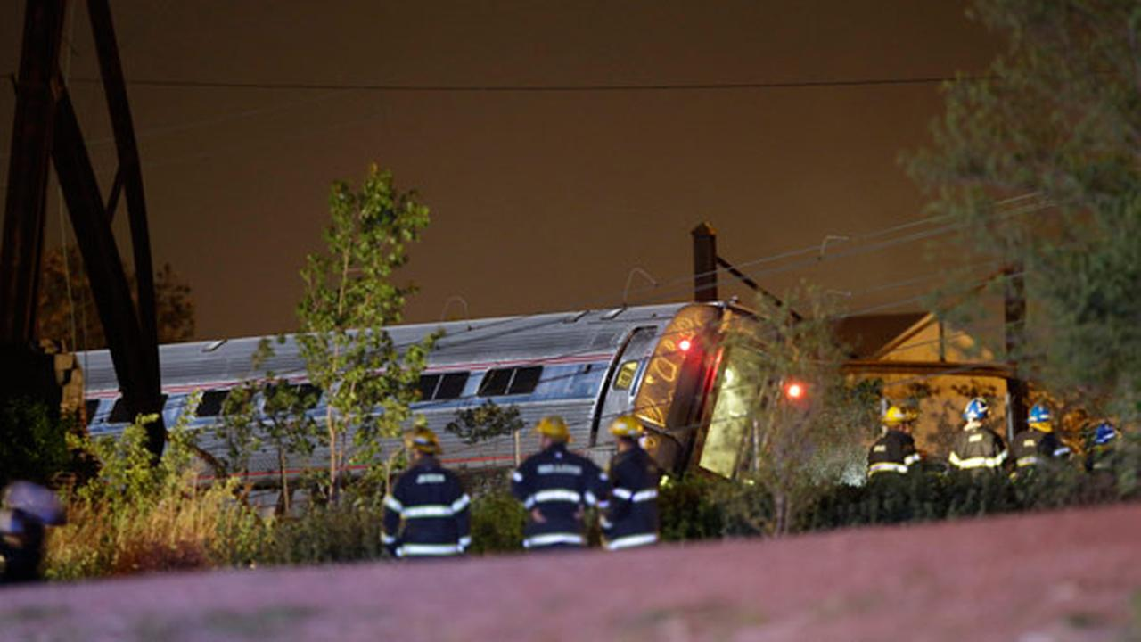 Emergency personel work the scene of a train wreck, Tuesday, May 12, 2015, in Philadelphia.