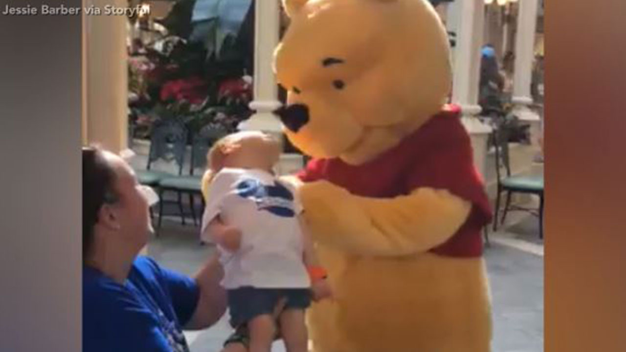 Winnie the Pooh shares touching moment with disabled child.