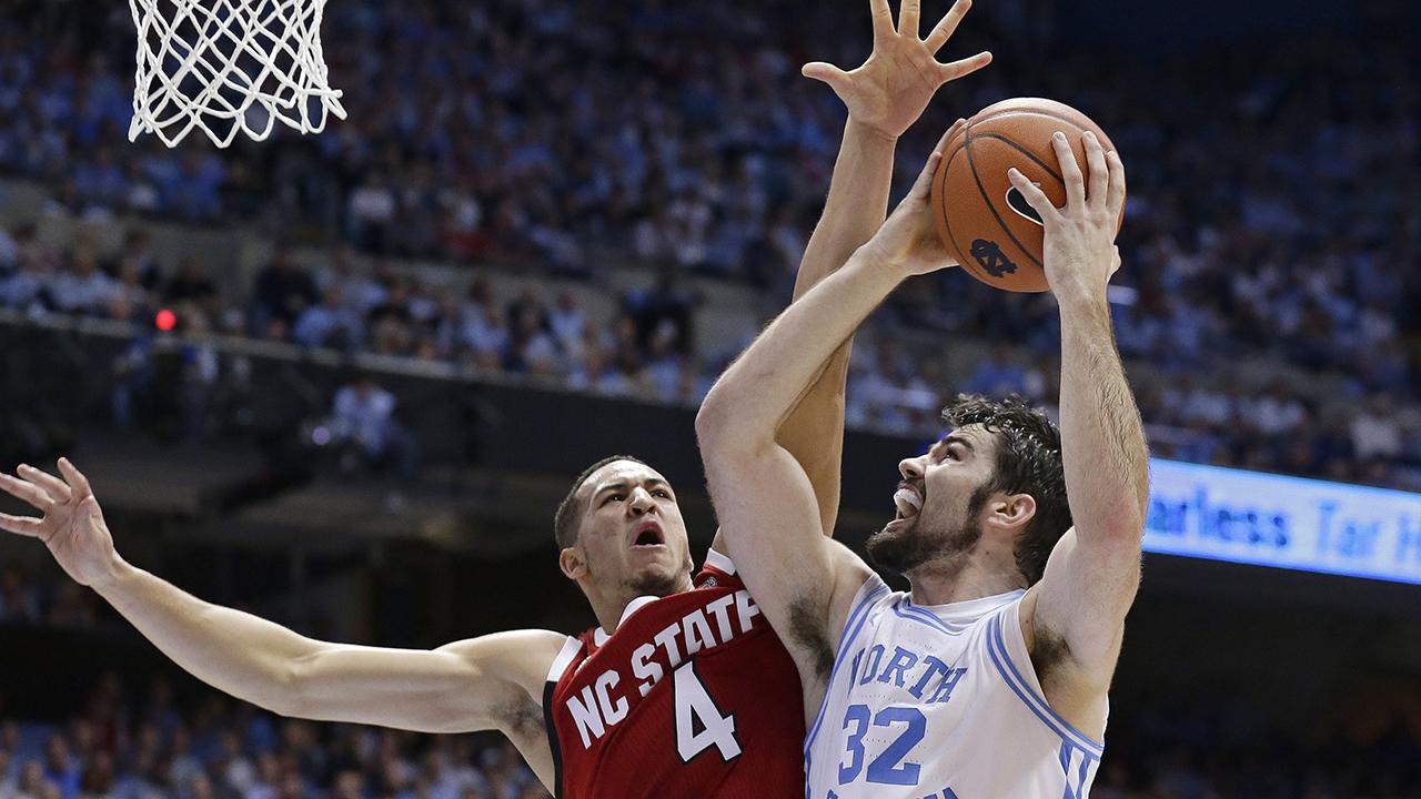 North Carolinas Luke Maye (32) drives to the basket against North Carolina States Jericole Hellems on Tuesday night.