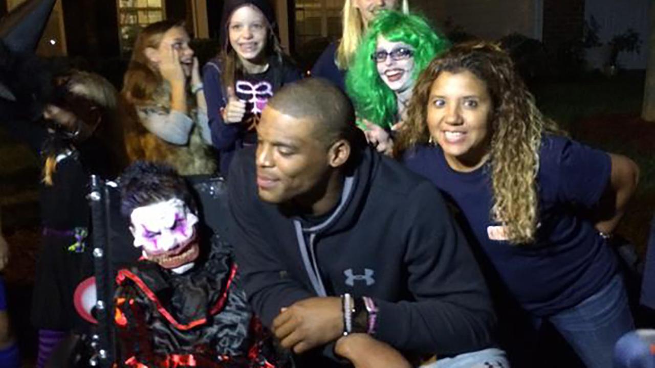 Cam Newton visits 10-year-old Elijah Hughes at a Halloween party