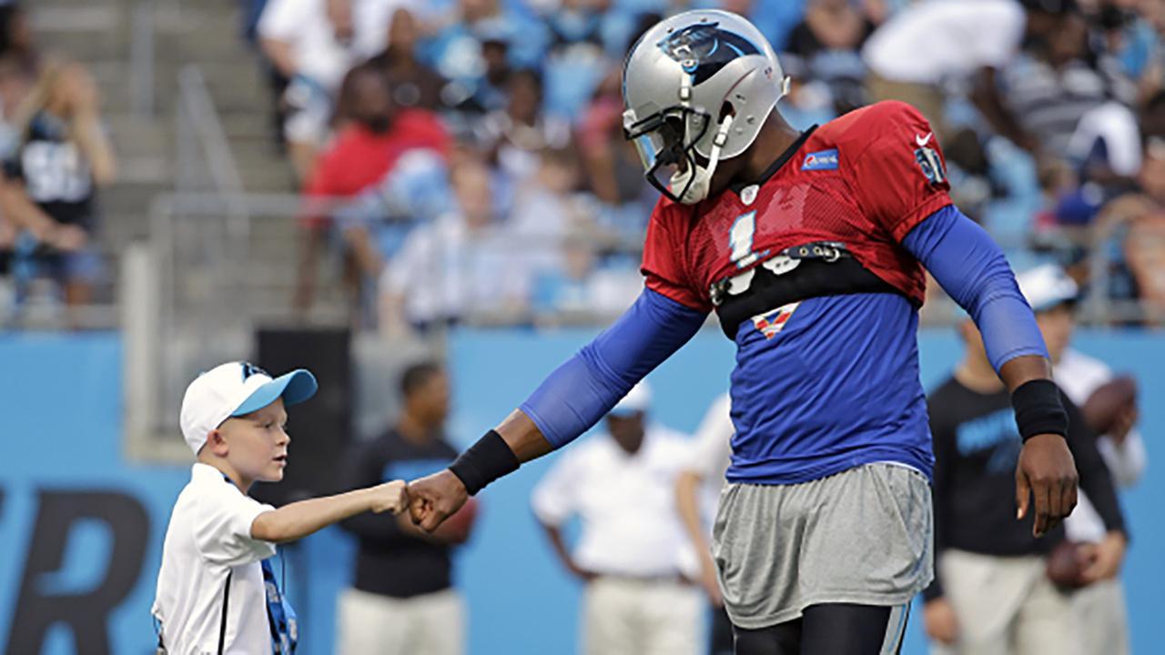 6-year-old Braylon Beam with quarterback Cam Newton