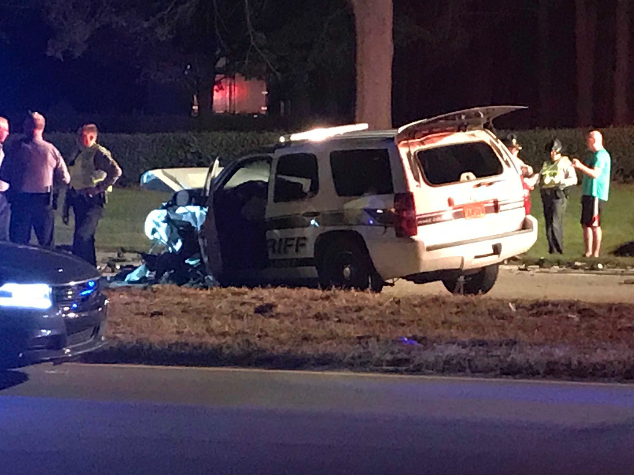 Emergency crews respond to the scene of a two-vehicle crash that left a Wake County deputy and another driver injured Tuesday night.