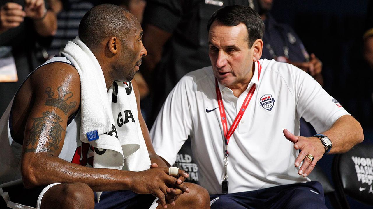 U.S. mens Olympic basketball team forward Kobe Bryant, left, talks with head coach Mike Krzyzewski during a practice Saturday, July 14, 2012, in Washington.