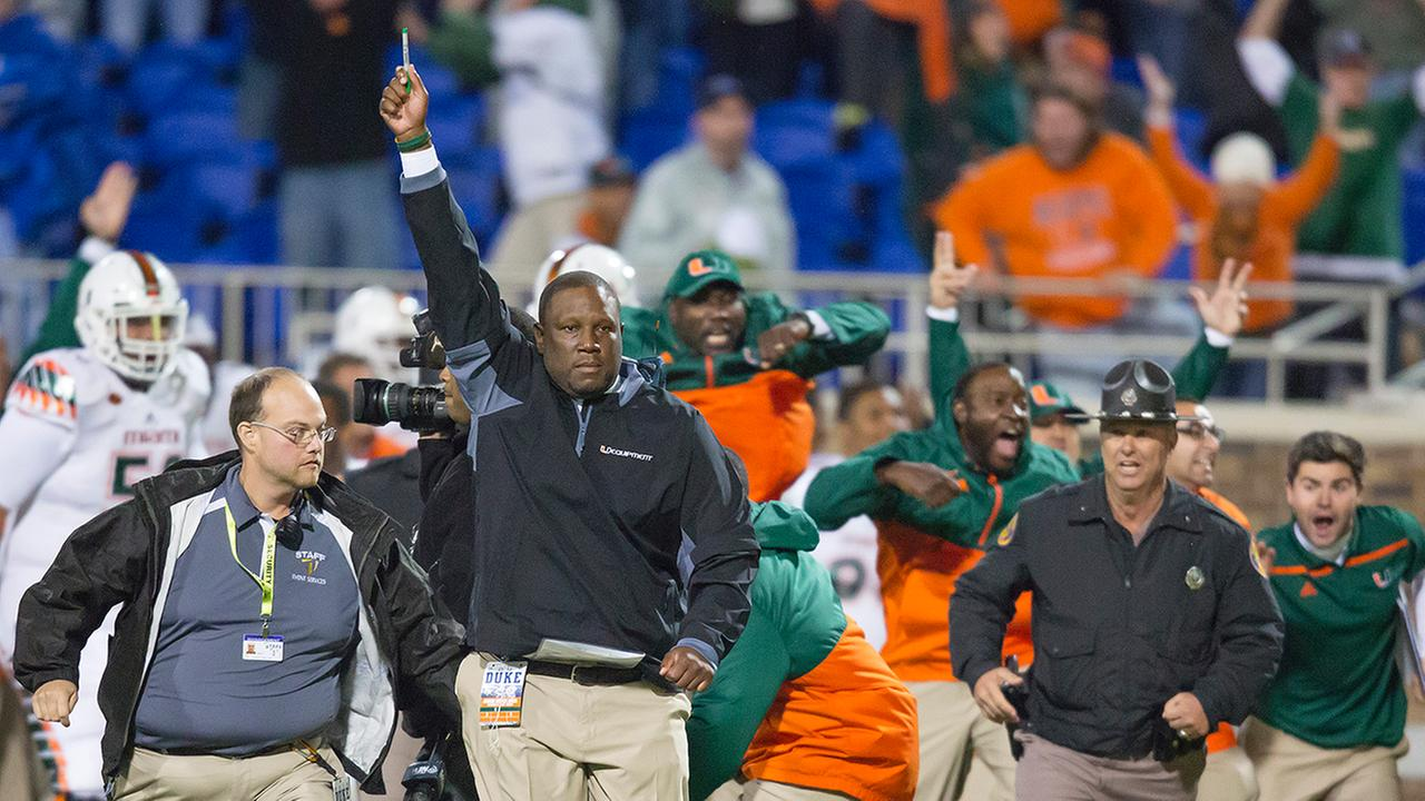 Miamis interim head coach Larry Scott raises his hand after defensive back Corn Elder returned a kickoff