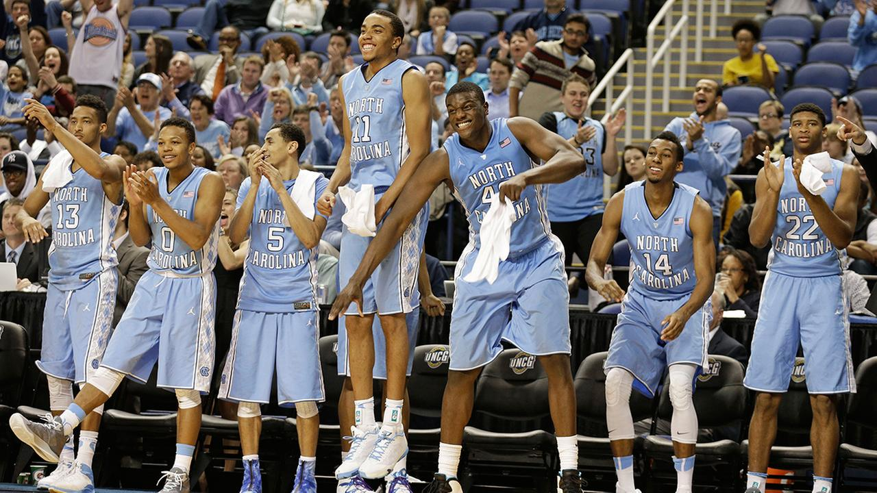North Carolina players react after a teammates basket against UNC Greensboro basketball game in Greensboro, N.C., Tuesday, Dec. 16, 2014. North Carolina won 79-56.