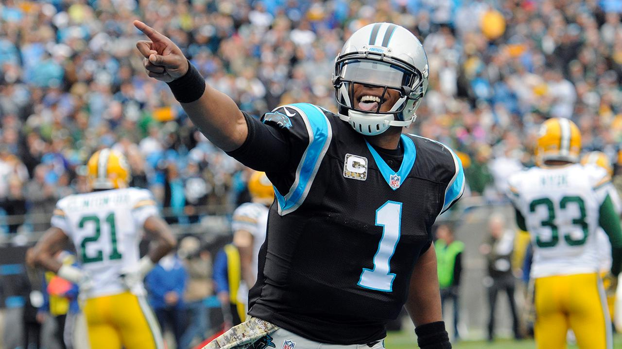 Carolina Panthers Cam Newton (1) celebrates his touchdown pass against the Green Bay Packers