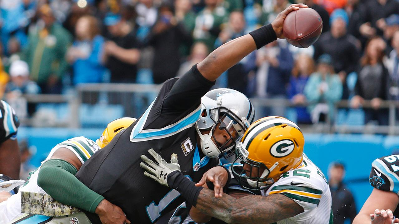 Carolina Panthers Cam Newton (1) reaches the ball over the goal line for a touchdown against the Green Bay Packers