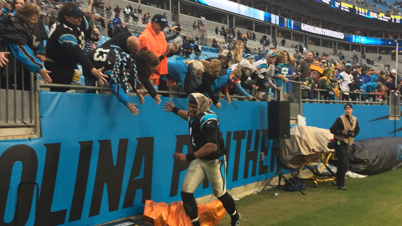 Quarterback Cam Newton celebrates after a win over the Green Bay Packers