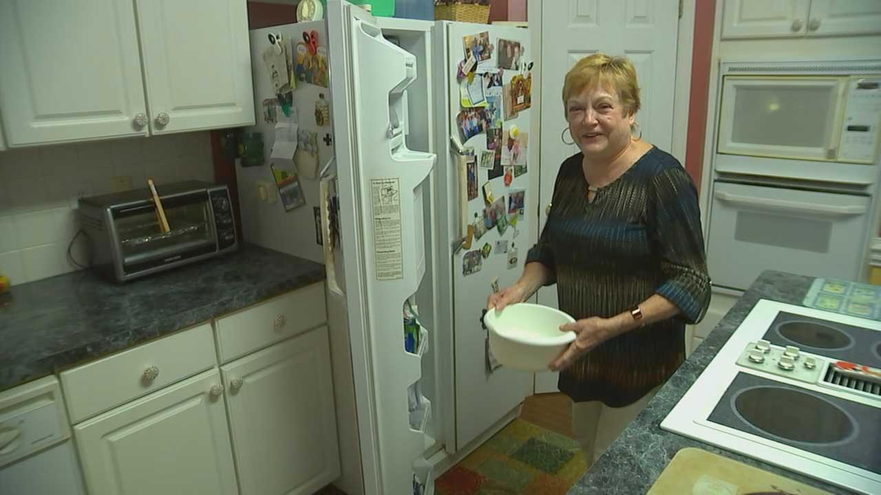 Marcia Morton displays her broken ice machine